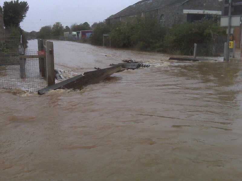 Track between Exeter - Tiverton Parkway flooded: Flooding