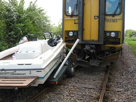 Boat towed by car collides with train (1), Barton-on-Humber