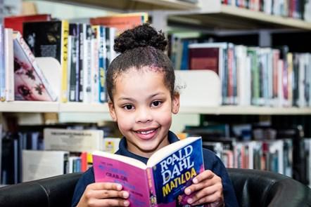Thandiwe gets stuck into Roald Dahl's children's classic, Matilda.: Thandiwe Dawethi-Cullen, 7, gets stuck into Roald Dahl's children's classic, Matilda.
