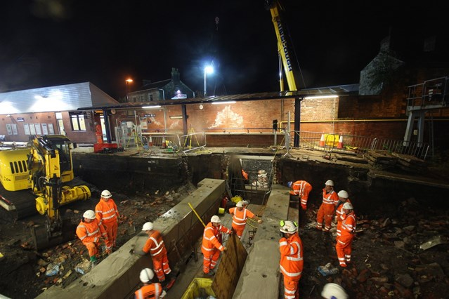Bank holiday upgrade work completed as railway reopens on time: The orange army working overnight to replace the subway at Chorley station