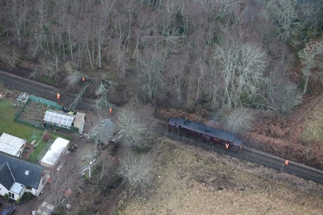 Engineers work to clear fallen trees at Dingwall, Scotland after a storm: Offering Rail Better Infomation Service (ORBIS) tree database