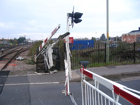 Barriers severely damaged after a road/rail collision in Gloucester.
