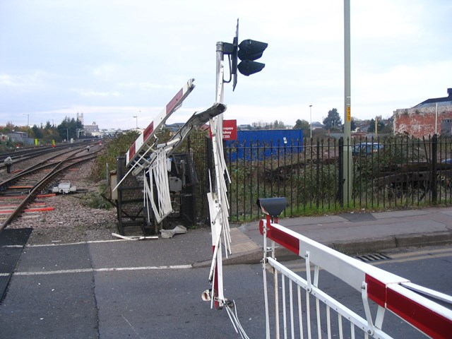 Barriers severely damaged after a road/rail collision in Gloucester.: DRTR