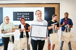Roxana Birca, Gather & Gather Barista of the Year with her award