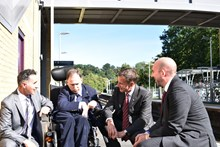 Stuart Kistruck, route managing director of Network Rail's Wessex route, Jeremy Hunt MP and Andrew Crawte, a local campaigner for disabled access discuss the benefits of the new accessible footbridge