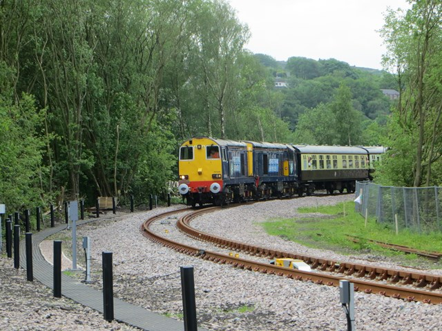 One of the first trains to use the completed Todmorden Curve