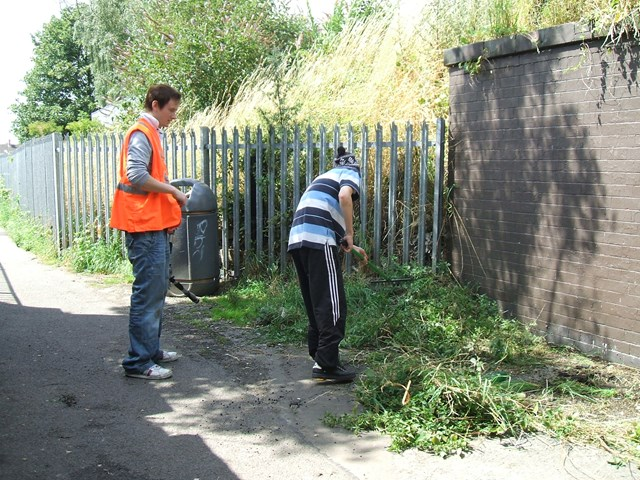 Young offender clearing vegetation at Grantham Station