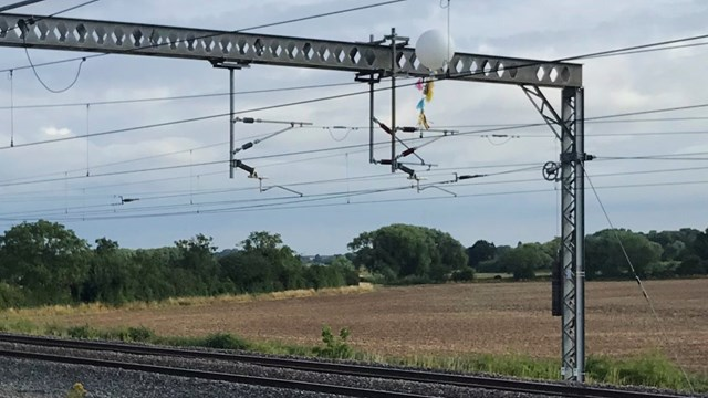 Balloon tangled in the overhead electric lines power trains in Tamworth