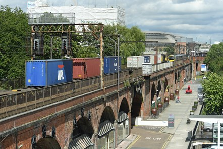 Freight train and passenger train at Manchester Oxford Road