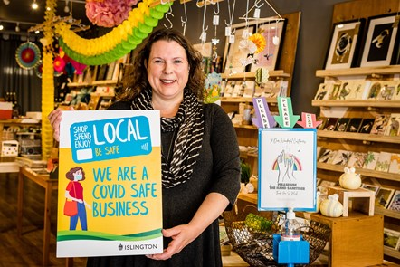 Georgina Black, of Pretty Shiny Shop in Stroud Green Road, Finsbury Park, promoting the Covid-Safe Business Award scheme window stickers