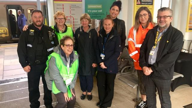Staff who took part in the World Mental Health Day event at Ormskirk station: L-R, PC Pattison (BTP), Margaret (Samaritans), Chris (Samaritans), Jilly (Samaritans), Kelly (mental health nurse), Alex (Network Rail), Chelsea (Network Rail), Lee (Merseyrail)