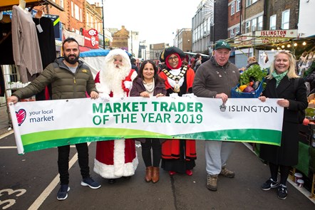 Market Trader of the Year 2019: Islington Market Trader of the Year 2019 - (L-R) Racheed Muhammed of Sunny's Olive Tree, Santa, Serpil Erce, the Mayor of Islington Cllr Rakhia Ismail, Dave Jackson and Christine Lovett, chief executive of Angel.London