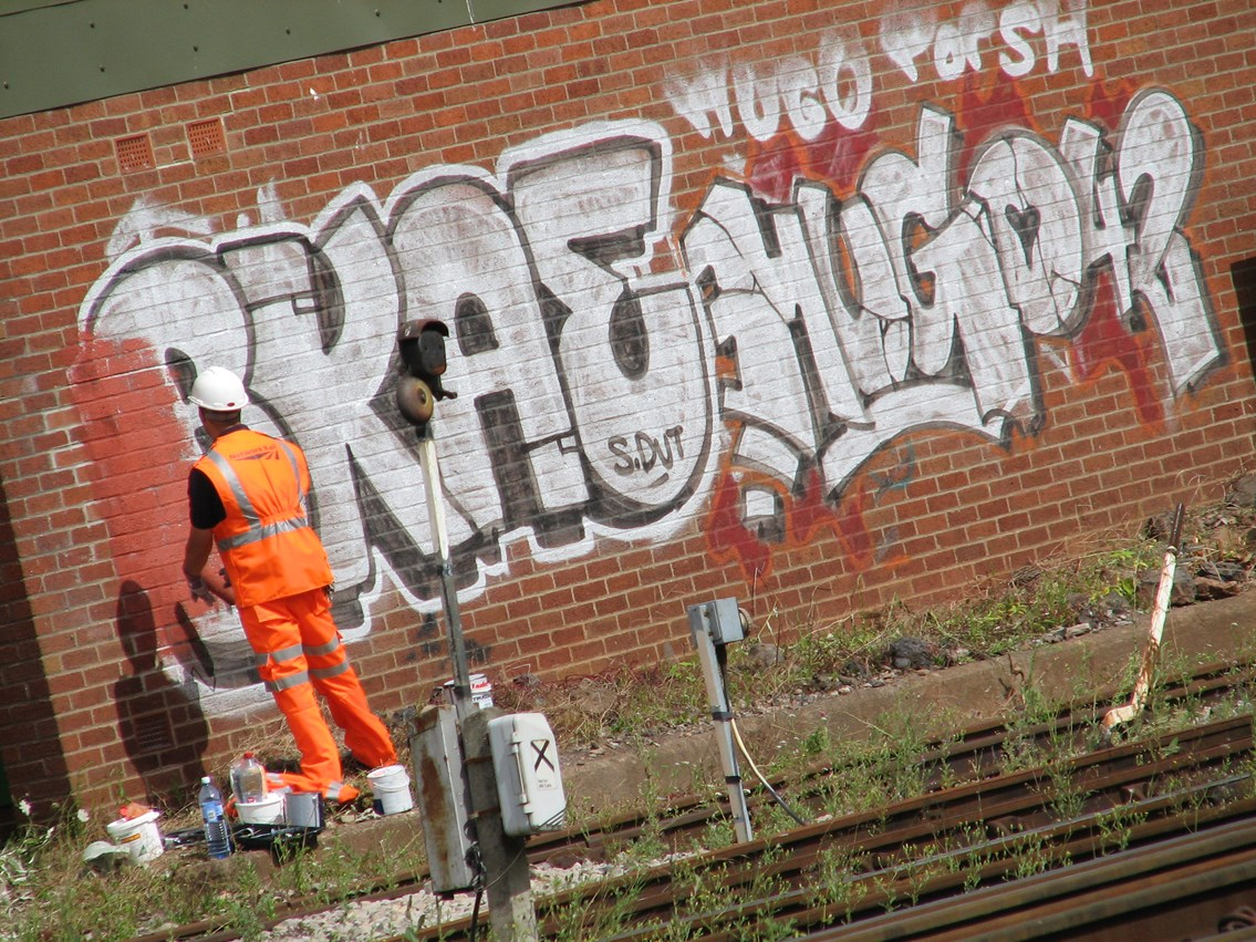 Graffiti is painted out - Bristol Temple Meads: Bristol Temple Meads - one mile clean up either side of the station, 31 July 2006