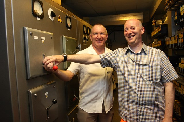 Nottingham resignalling: Trent Power Signal Box is switched out: Nottingham resignalling: Signals and telecoms engineer Peter Short and resignalling programme managerDave Scarth pull the lever to switch off the panel and turn off the box.
