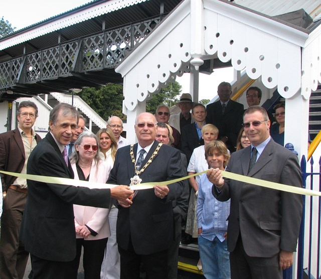 Taplow Station footbridge unveiling: Taplow Station footbridge is officially unveiled by Network Rail's Site Manager Martin Kaye (right), Chairman of South Bucks District Council Peter Adams (centre) and TRUG Chairman Jon Willmore (left)