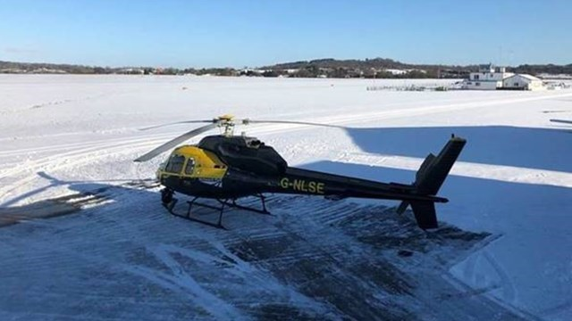 Network Rail helicopter preparing for take off in the snow - Credit: Network Rail Air Operations team