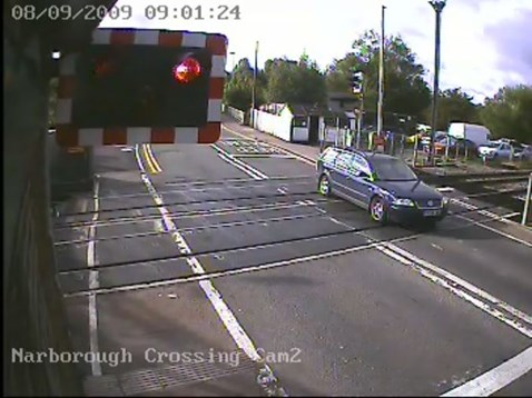 Motorist ignores warning lights at Narborough level crossing, Leicester