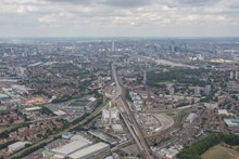 aerial - Bermondsey and London Bridge: Bermondsey Dive under in the foreground, with the Shard and London Bridge in the distance. That's the New Den at left (Millwall FC) and Arriva London's sidings on the right.
