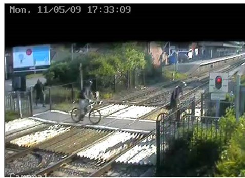 Cyclists ignore warning lights at Wareham level crossing, Dorset