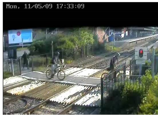 NETWORK RAIL GIVES SUPPORT TO BUILD FOOTBRIDGE AT WAREHAM: Cyclists ignore warning lights at Wareham level crossing, Dorset