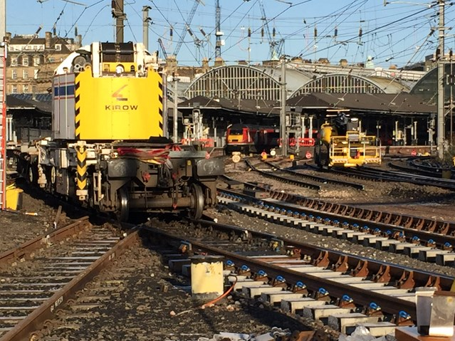 Train services back to normal as major improvement work at Newcastle station completes: Kirow bringing the panels from the station storage area to be placed in position with a VTEC train in the station