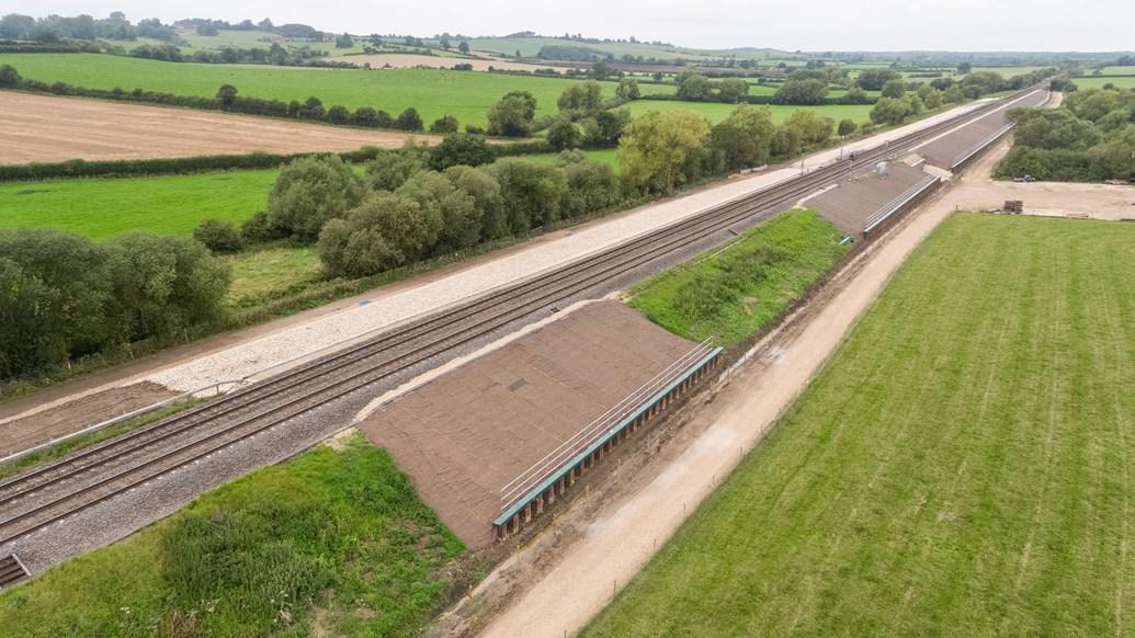 Orange army use cost-saving Japanese method to stabilise railway: Bridge Farm ground works aerial view. Aylesbury.
