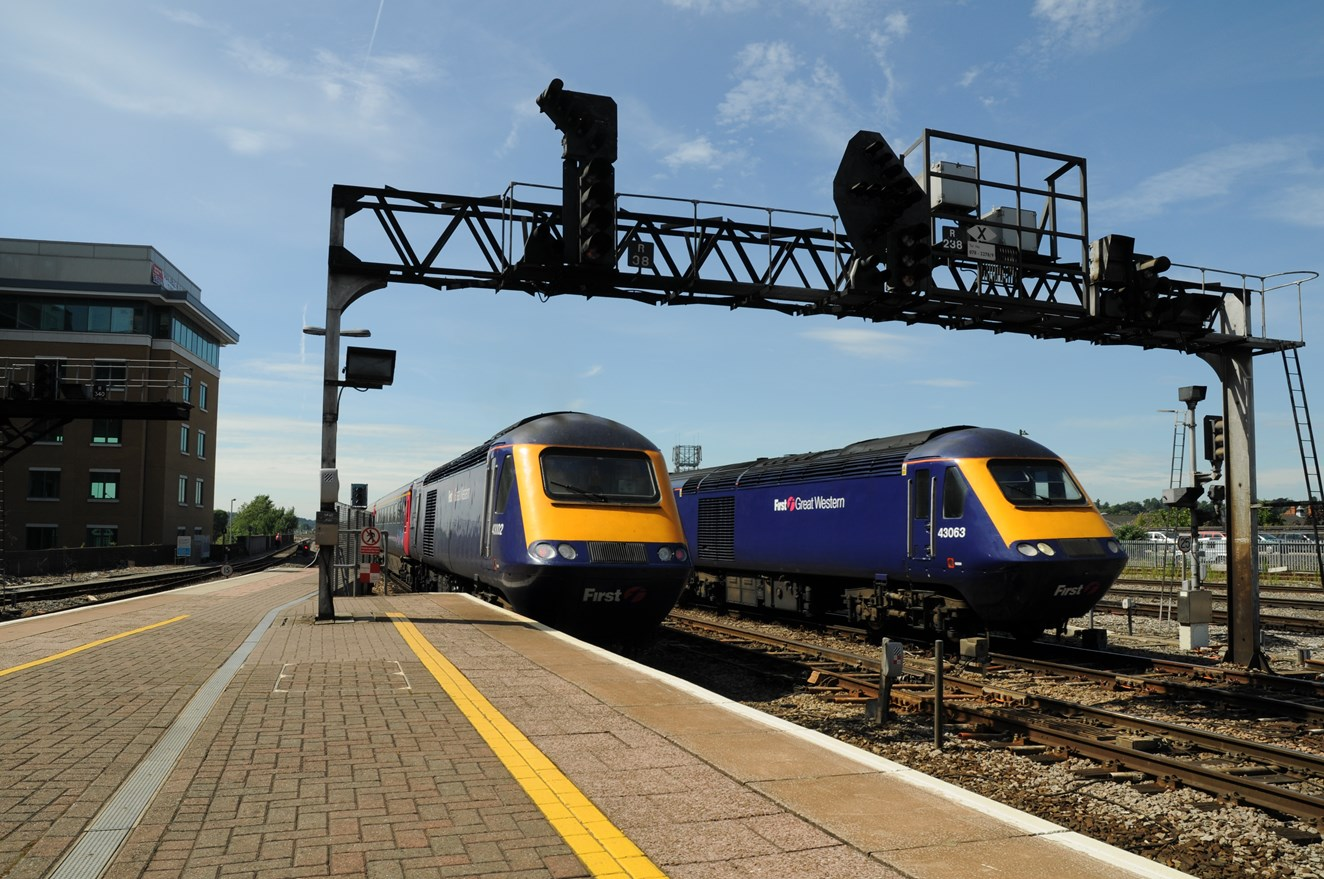 NETWORK RAIL BOOSTS CROSSRAIL AND READING PROJECTS: Passenger trains approaching Reading station
