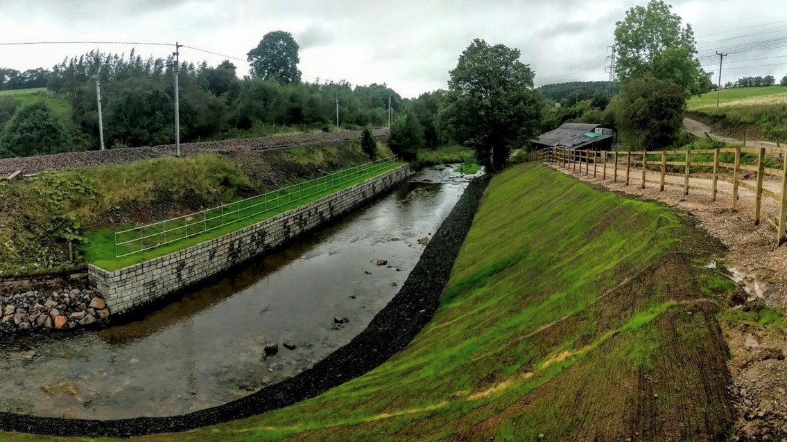 River protection work keeps West Coast main line passengers on the move: The River Leith beside the West Coast main line