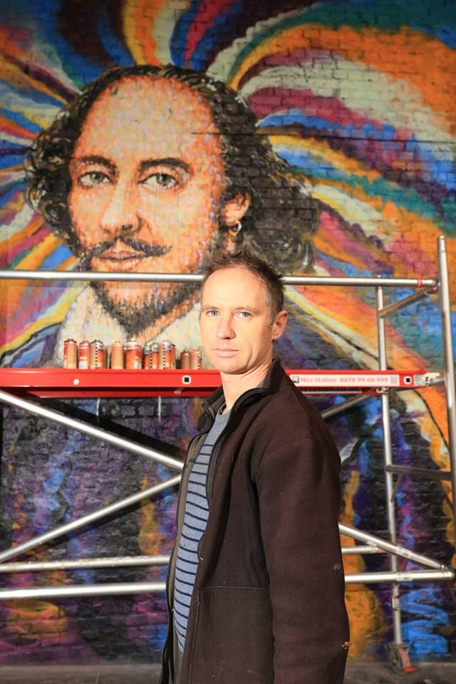 Jimmy C best portrait: Street artist Jimmy C works on a portrait of William Shakespeare on a Network Rail wall in Southwark