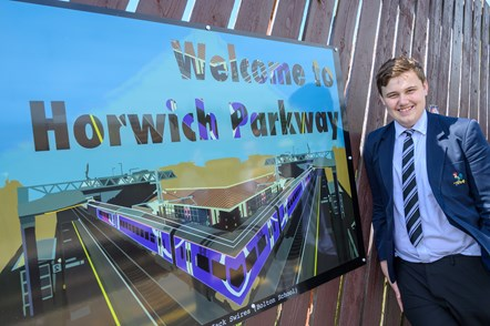 Bolton school student with artwork at Horwich Parkway Station: One of the students from Bolton School stood with the artwork created to to be displayed at Horwich Parkway station.
