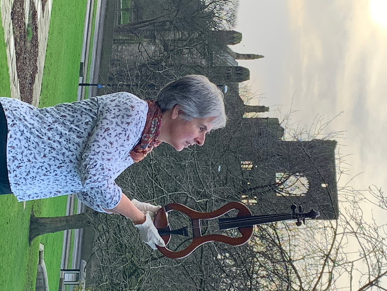 Sounds of Our City: Kitty Ross with an instrument on display as part of Sounds of Our City at Abbey House Museum.