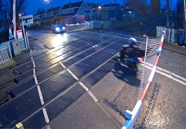 Shocking video shows kids on a moped swerving around level crossing barriers in Greater Manchester: Navigation Street level crossing missuse 4