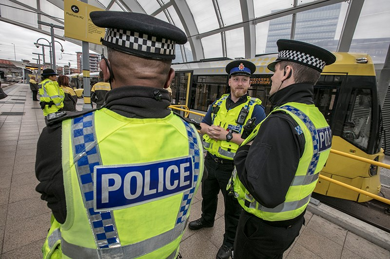 TravelSafe Unit officers with tram at Victoria Station