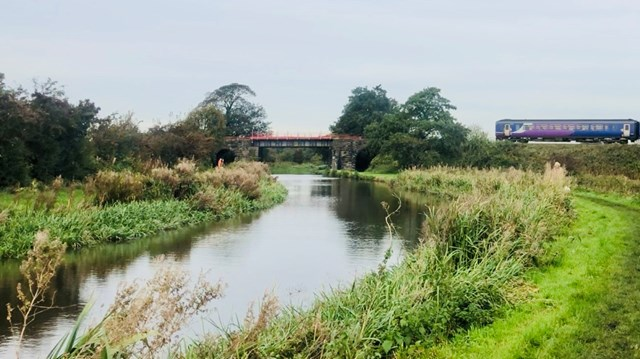 Northern train about to cross old bridge in Burscough October 2019