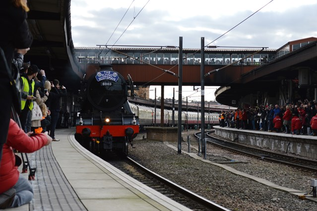 Flying Scotsman fans urged to stay safe during trips from London to Surrey, Hampshire and Wiltshire: The Flying Scotsman pulls into York with platforms crowded and the over bridge full