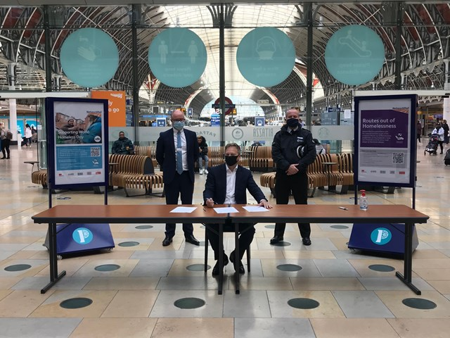 Rail industry and charities join forces to tackle street homelessness with new Rough Sleeping on Rail Charter: Andrew Haines, Grant Shapps and Charlie Doyle signing homelessness charter