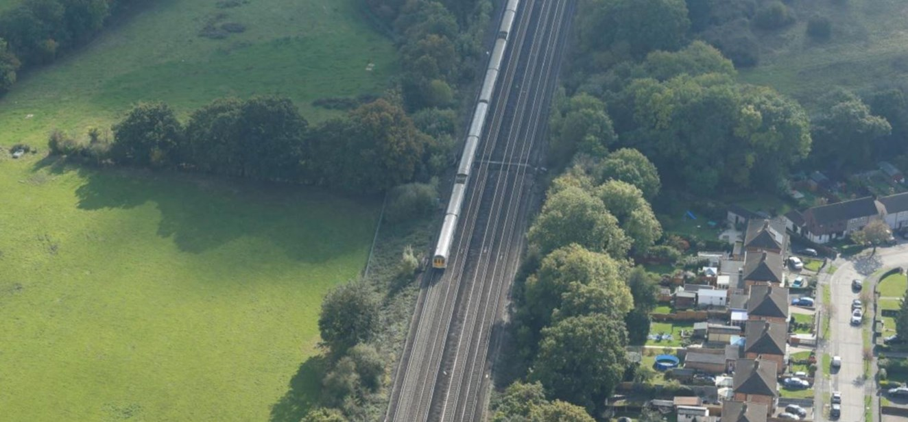 New railway footbridge over Brighton Main Line in Salfords, Surrey, to improve safety for pedestrians: Dean Farm aerial (landscape)
