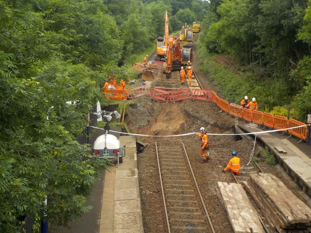 The Orange Army on site repairing flood damage at Middlewood