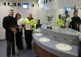 Ross Totney, Councillor Emma Stokes and Eric Johnson with the trophy inside the award-winning toilet at St Andrew's Precinct in Droitwich.