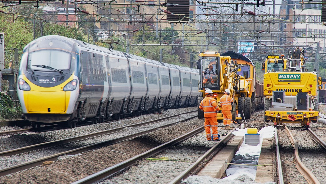 Rapid railway renewals on West Coast main line in North London: Avanti West Coast train passing Willesden track upgrade worksite March 2021