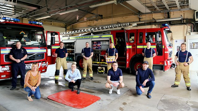 Railway manager helps organise lock-downgive-away of 1,000 Easter eggs: Network Rail's Chris Williamson (BOTTOM RIGHT) with firefighters at Whitehaven fire station before Easter egg giveaway