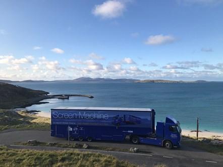 Screen Machine on Eriskay, Barra in distance