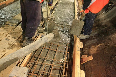 Pouring the concrete into the shuttering