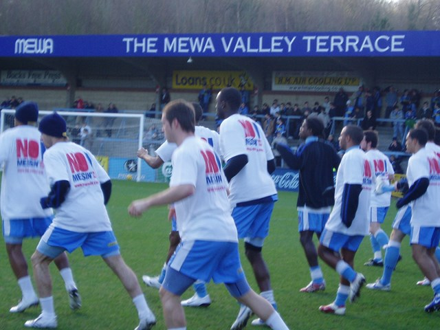 Wycombe Wanderers Players No messin'! warm up 1 Jan 07: Players warm up with special No messin'! T Shirst to help get across the rail safety message