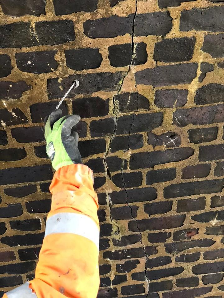 Strengethening cracked masonry on underside of Ribblehead viaduct arch