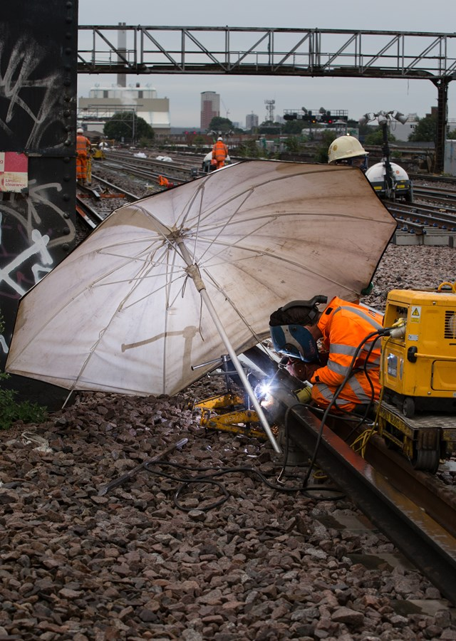 Engineer braving the elements at London Bridge - late August bank holiday: With the new Mobile Maintenance Trains (MMTs), scenes like this will be a thing of the past