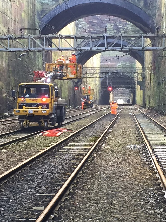 Five-year, multi-billion pound plan for 'Backbone of Britain' railway unveiled: Overhead wires repairs in the cutting approaching Liverpool Lime Street station