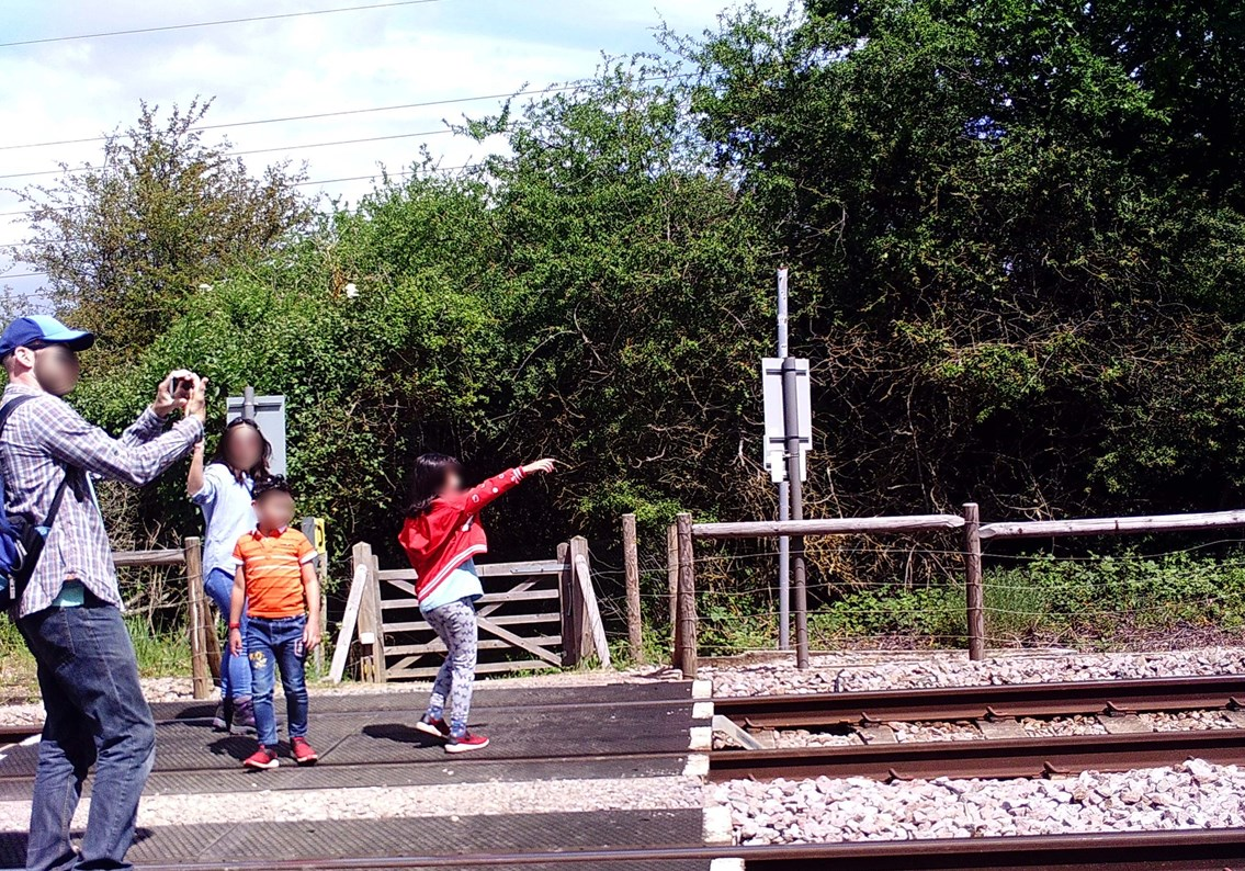 Network Rail issues warning after a family were found taking photographs on the railway lines in Essex: Knights level crossing misuse 2