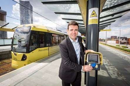 A photograph of Mayor Andy Burnham using contactless on a Metrolink stop