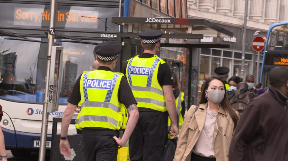 Greater Manchester Police officers near to a bus